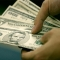 Споры о новой мировой валюте не мешают росту спроса на доллар